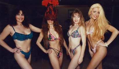 group shot of Rain and her tribe: Tahoe's Exclusive Exotic Striptease Dancers